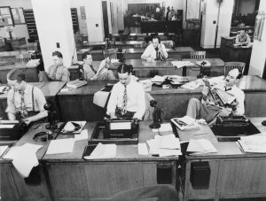 a buncha white NYT reporters in the news room in the 1930's