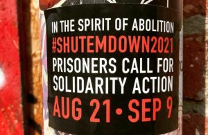 """A sticker announcing """"In The Spirit of Abolition 