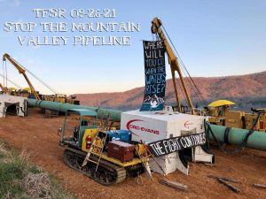 """Banners left on pipeline construction equipment, reading """"Where Will You Go When The Waters Rise?"""" and """"The Fight Continues"""""""