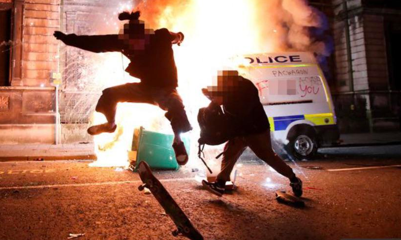 Skateboarder doing sweet tricks in front of burning cop van in Bristol on March 21, 2021, photographer catching the moment